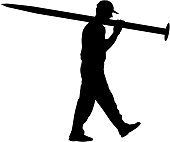 Silhouette Porter carrying the large nail in his hands,