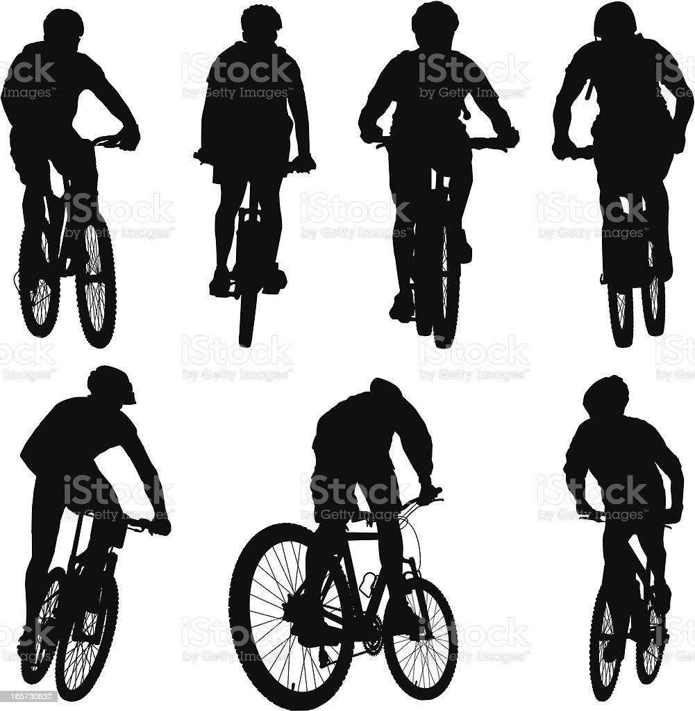 Silhouettes of Mountain Bikers vector art illustration