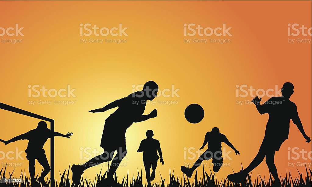 Silhouettes of people playing soccer as the orange sun sets royalty-free stock vector art