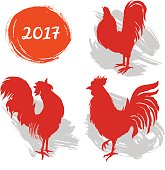 Silhouettes of roosters. Cock illustration. Symbol 2017 New Year.
