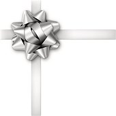 Silver gift bow with ribbons