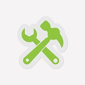 simple green icon - claw hammer with spanner