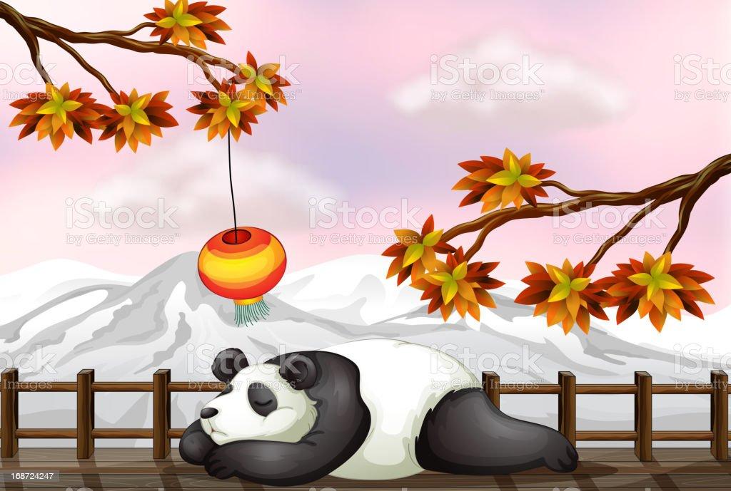 Sleeping bear and a snow mountain vector art illustration