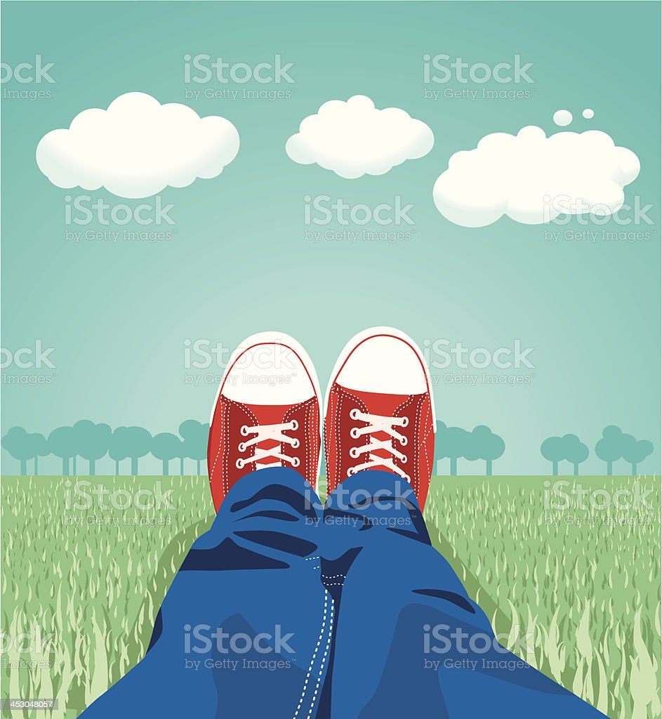 Sneakers on the meadow vector art illustration