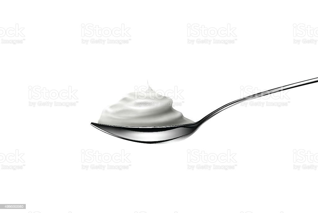 Sour cream in spoon on white background vector art illustration