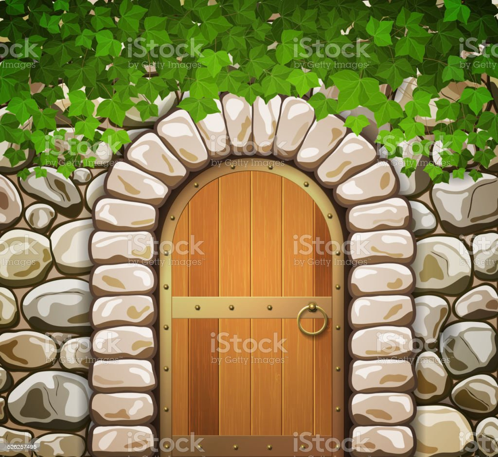 Stone wall with arched medieval wooden door and leaves vector art illustration