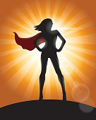 Superhero Girl Standing with Cape Waving in the Wind Silhouette
