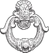 the ancient door handle in the form of the decorative ring