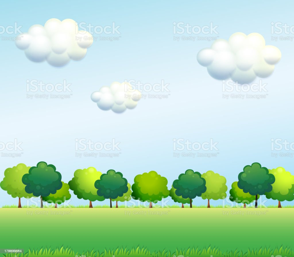 The green trees below  clear blue sky royalty-free stock vector art