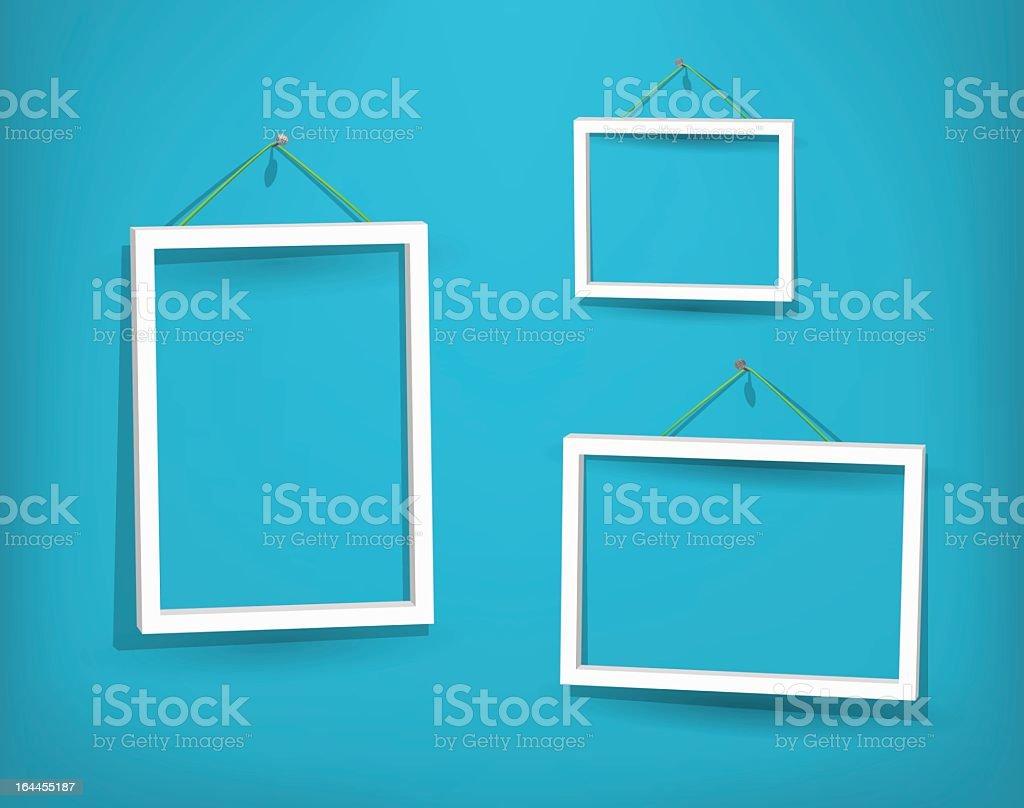 Three empty white frames on the wall vector art illustration