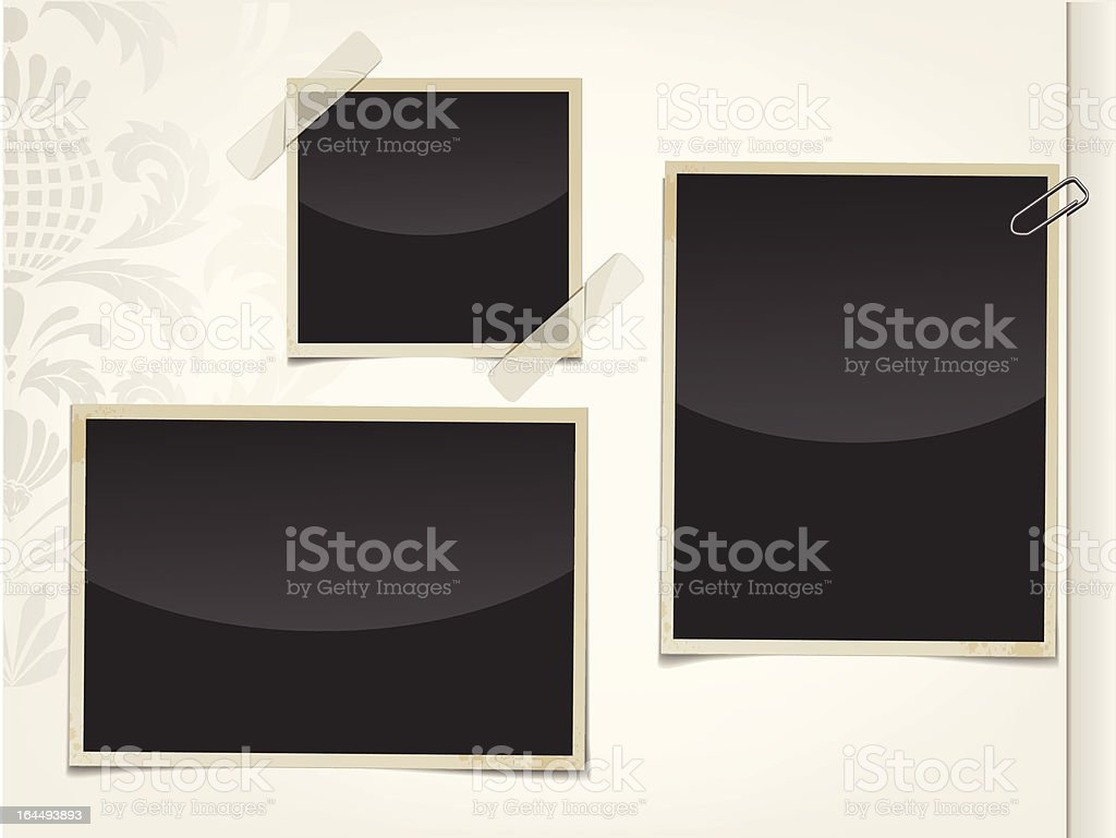 Three retro black photos taped and clipped to an album page royalty-free stock vector art