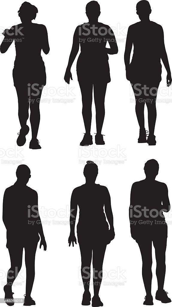 Three Women Walking Together Silhouettes vector art illustration