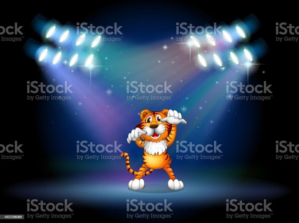 tiger raising her hands at stage under spotlights royalty-free stock vector art
