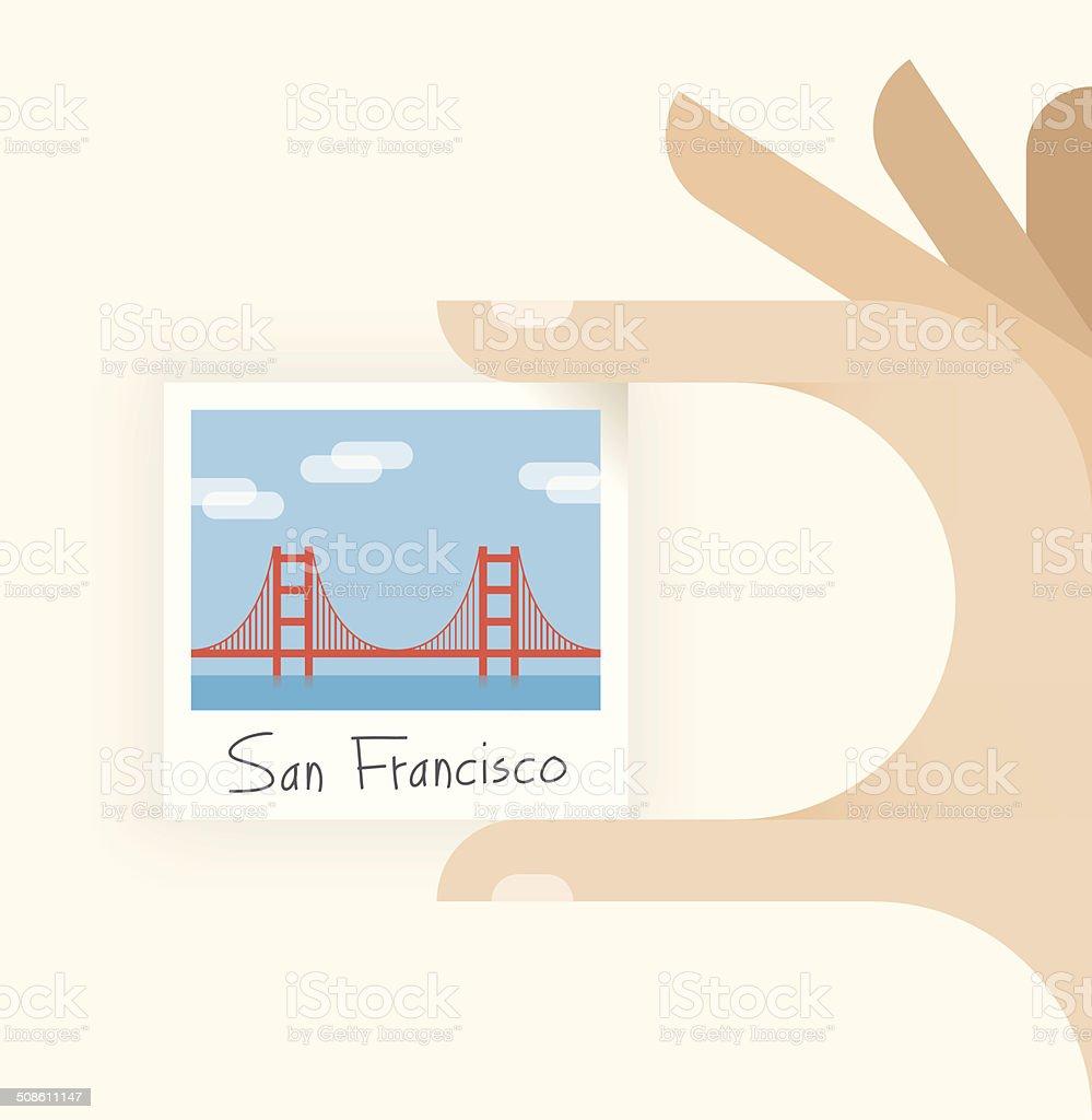 Tourist holding photography of Golden Gate bridge, San Francisco vector art illustration