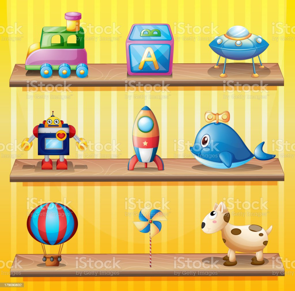 Toys arranged neatly in the wooden shelves royalty-free stock vector art
