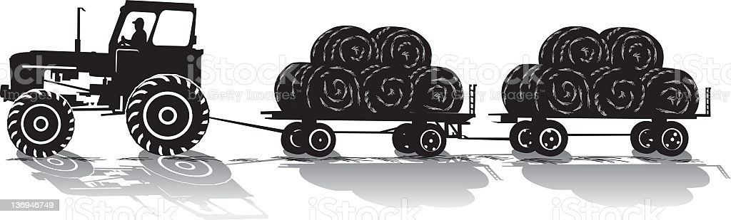 Tractor Pulling Hay wagons royalty-free stock photo