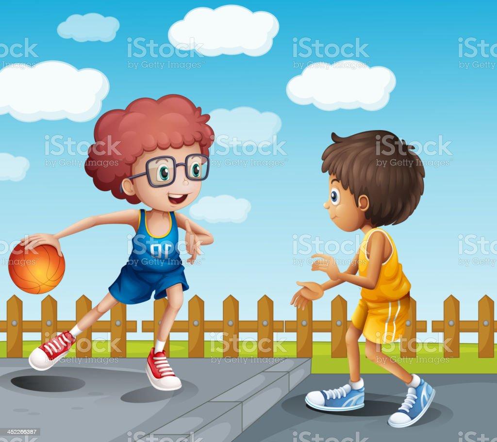 Two boys playing basketball royalty-free stock vector art