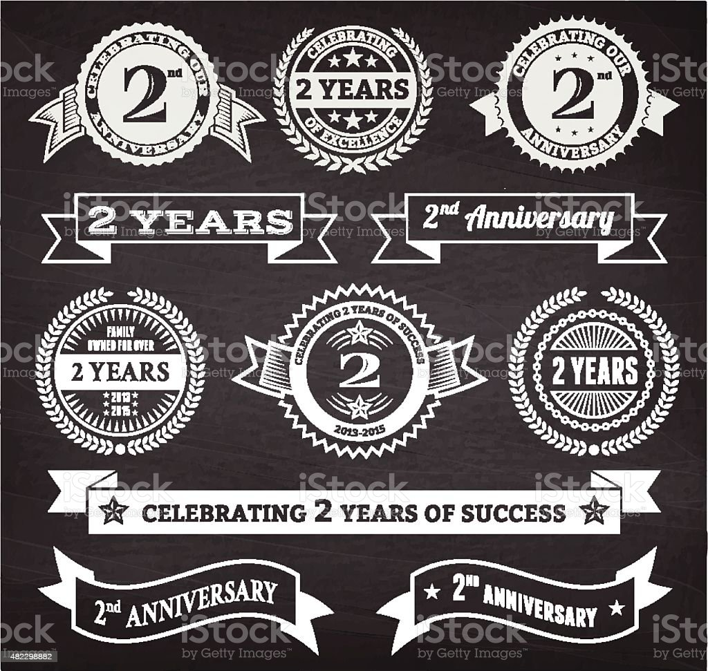 Two year anniversary hand-drawn chalkboard royalty free vector background vector art illustration