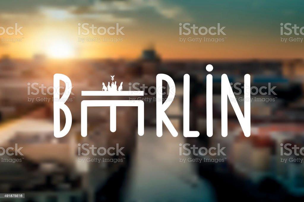 typographic berlin sign on blurred sunset skyline stock photo
