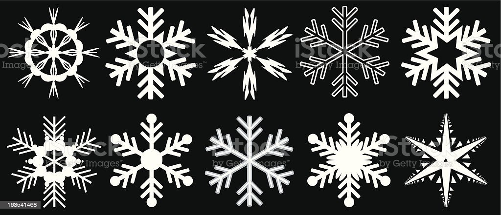 A variety of different white snowflakes royalty-free stock vector art