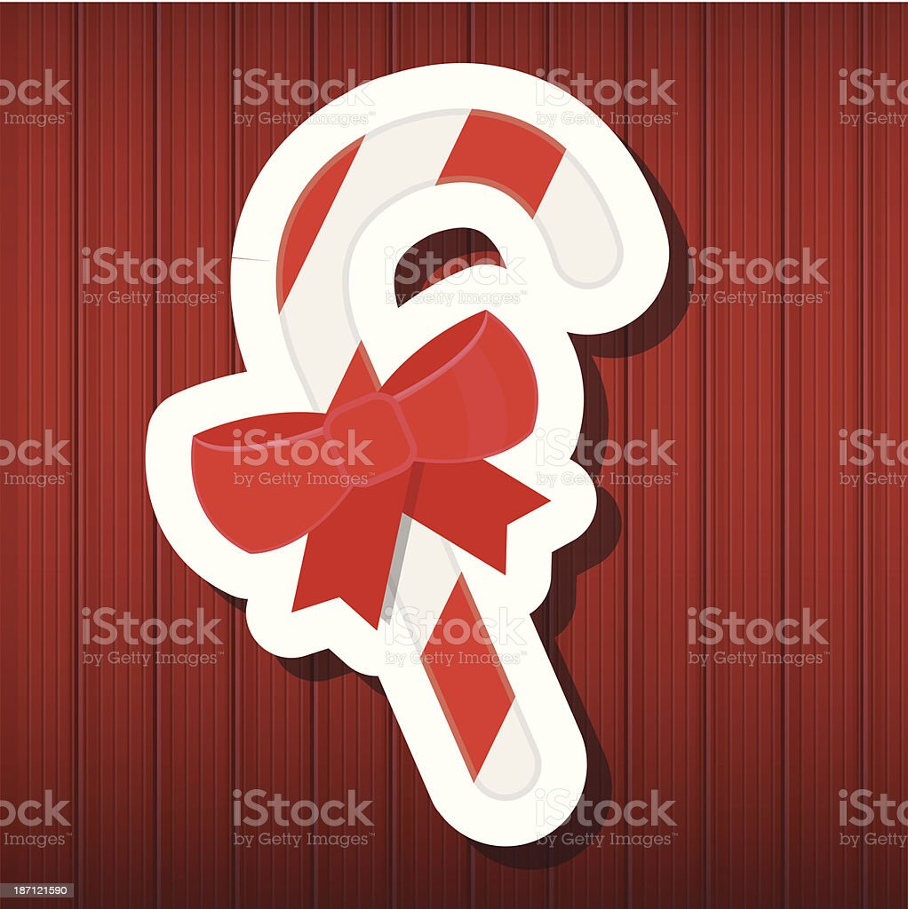 Vector Candy Cane on Wooden Background royalty-free stock vector art