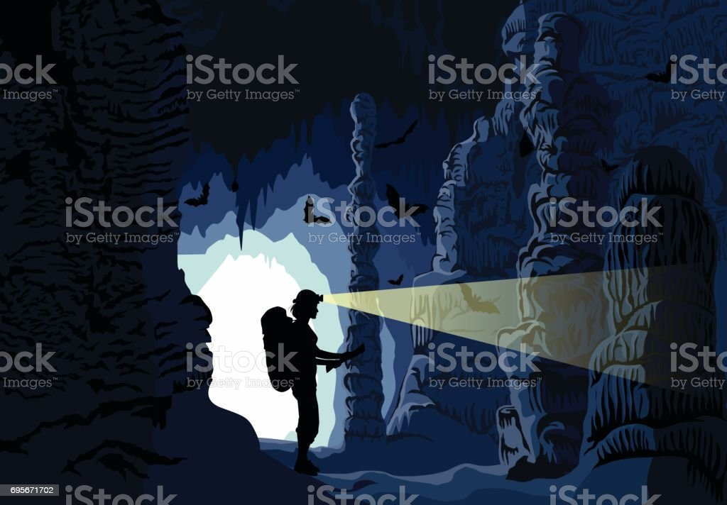 Vector girl caver in cave with stalactites and stalagmites and bats vector art illustration