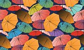 Vector seamless pattern with colored umbrellas