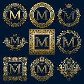 Vintage monograms set of M letter. Golden heraldic emblems