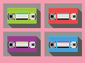vintage video cassettes in 1980s colors. colorful flat style
