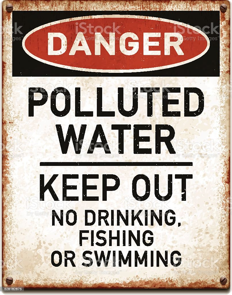 Weathered metallic placard with danger polluted water warning text_vector vector art illustration
