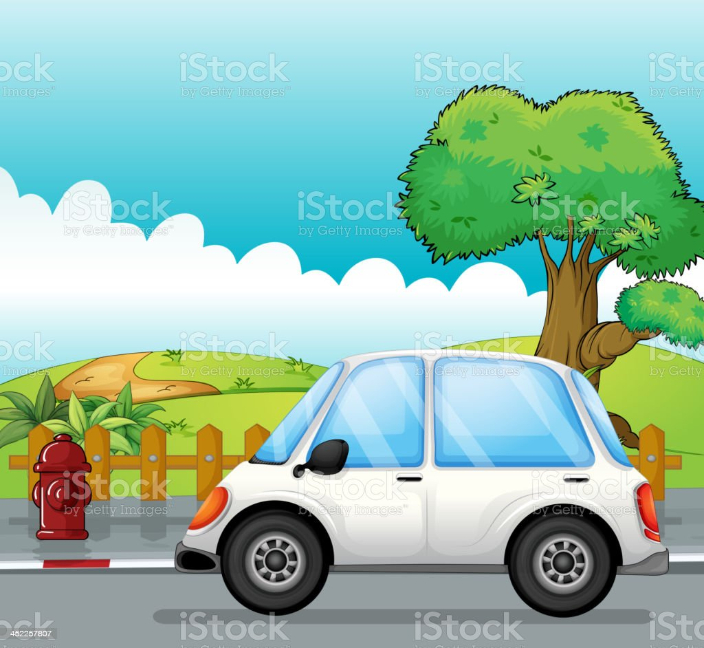 White car along the street royalty-free stock vector art