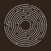 White circular maze on a black background