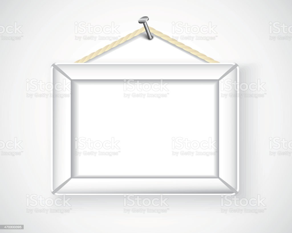 white picture frame hanging on the wall royalty-free stock vector art