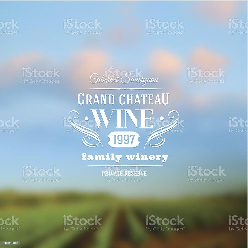 Wine label type design against a vineyards landscape defocused background vector art illustration