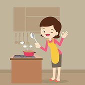 woman cooking showing ok sign