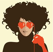 Woman with heart shaped sunglasses.