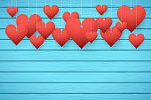 Wooden background with red hearts