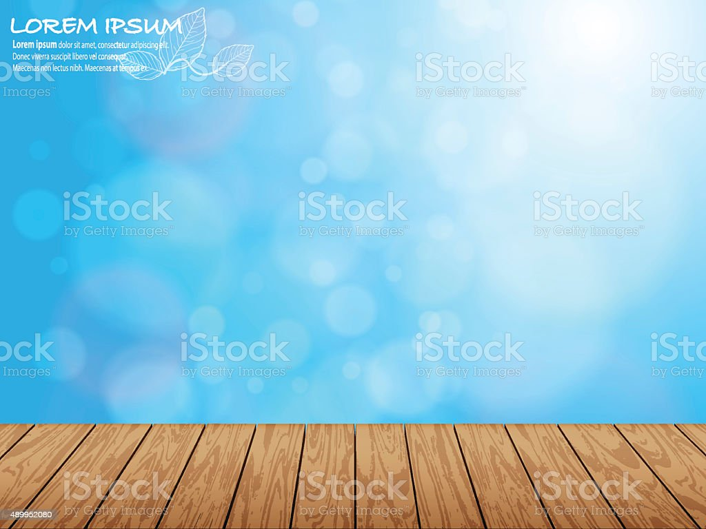 Wooden pieces and natural blue blur background stock photo