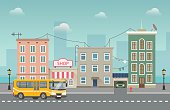 Yellow bus goes around small city with shops. Vector cityscape
