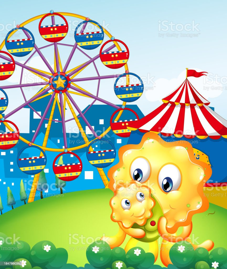 yellow monster and her child at the carnival royalty-free stock vector art