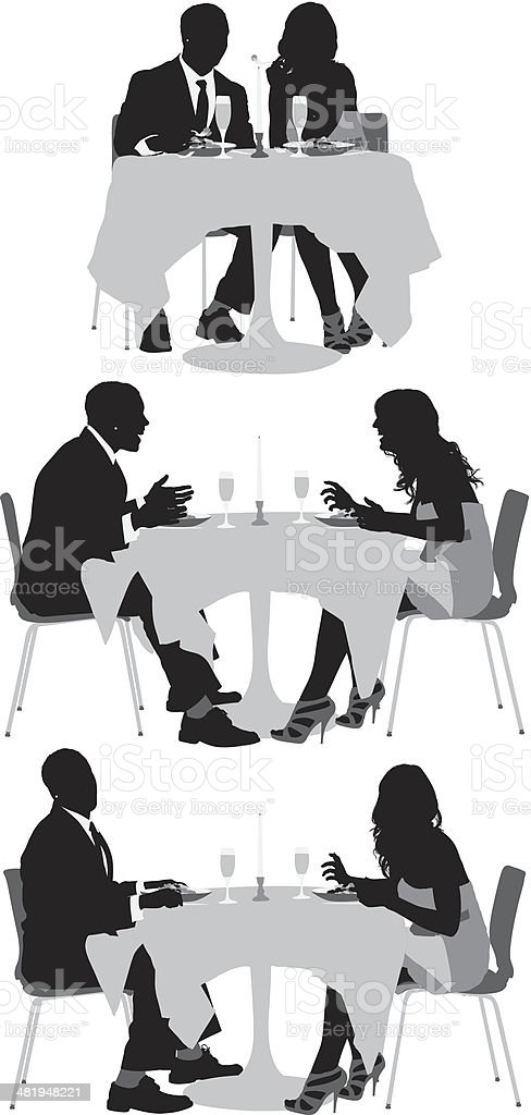Young couple at dinner table vector art illustration