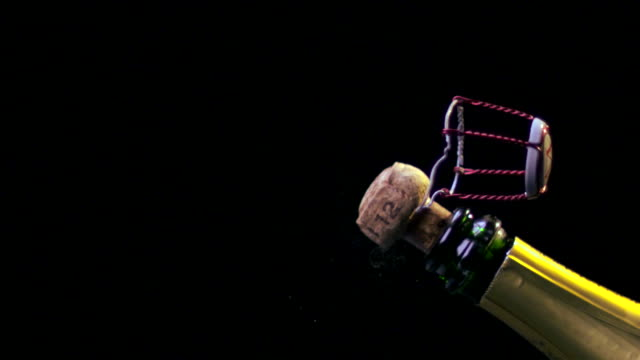 CHAMPAGNE CORK AND CAGE EXPLODING-SLOW MO-1080HD video