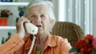 ELDERLY WOMAN TALKING ON PHONE-1080HD video