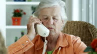 ELDERLY WOMAN ON PHONE-1080HD video