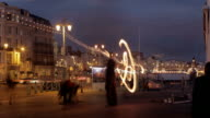 BUSY SEAFRONT FIRE JUGGLING NIGHT TIME video