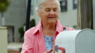 ELDERLY WOMAN CHECKING MAILBOX video