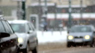 TRAFFIC IN THE SNOW, SNOWFLAKE, CAR TRAFFIC ON SLIPPERY ROAD, video