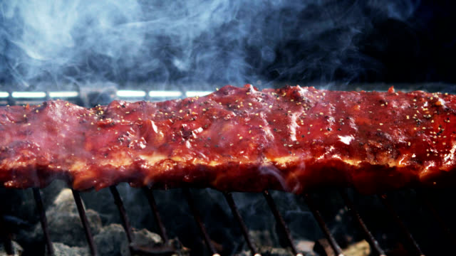 SPARERIBS ON GRILL-SLOW MOTION video