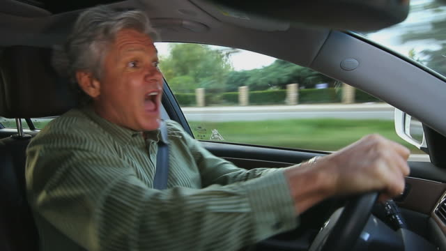 MAN GETS MAD WHILE DRIVING video