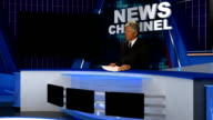 NEWS REPORTER AT CONSOLE video